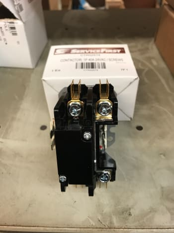 A single pole contactor only has to connect one wire for power. The other leg is just the neutral/common and is always in the circuit. On this part, the plunger is under the cover you see here.