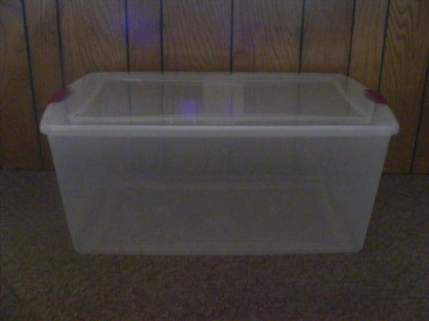 105-quart plastic, transparent storage bin.