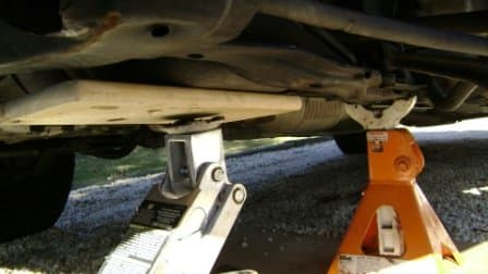 Support the engine with a jack.  Use a wood plank to prevent damage to the oil pan.