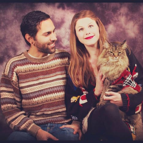 Every awkward family begins with an awkward couple.  The interesting sweaters and the cat are a double bonus!
