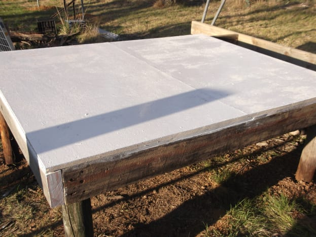The new hen house began with a raised platform at a convenient height for us to reach in and replace straw, and easily catch the chickens when necessary. No need to bend down to ground level. We painted the floor to seal it.