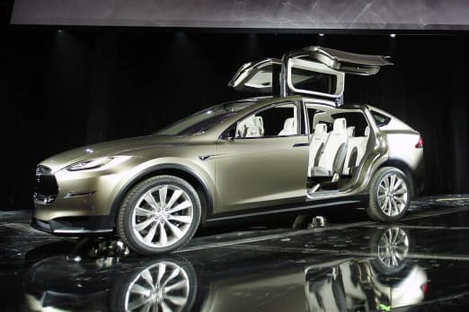 Tesla Model X - Oh yes! Well worth going into debt for . . . isn't it? What my friends will say! And the lady I just met? Mmmhmm!