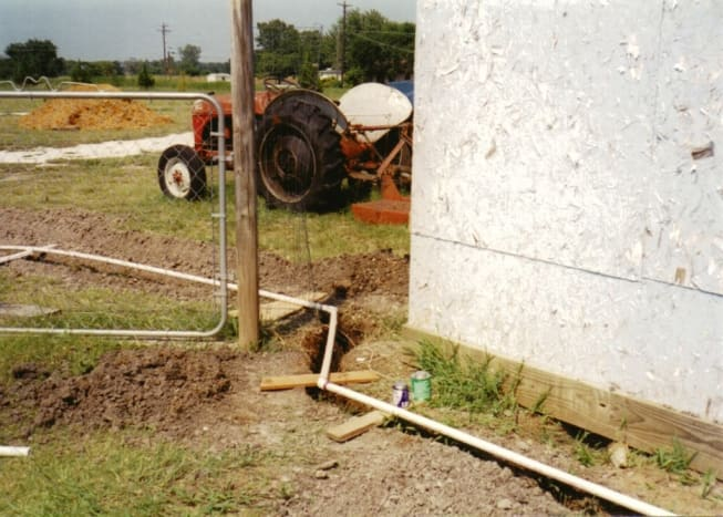Digging the trenches for the water line.