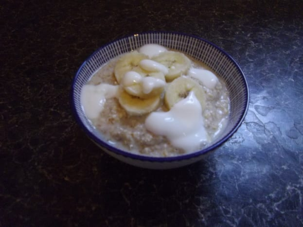 Bowl of porridge with banana and yoghurt.