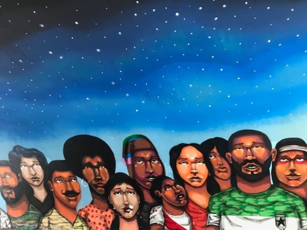 This mural adorned the walls of a tunnel in The Barranco district in Lima, Peru, when I visited in July 2018. The mural displayed a diversity of people looking up to the heavens.