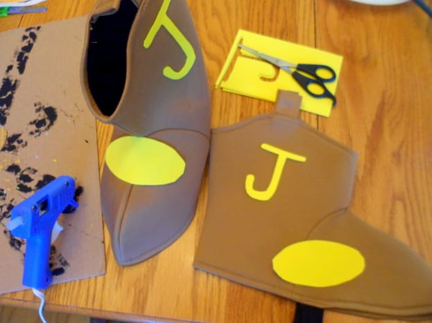 "Cut out 2 yellows ovals and the letter ""J"" out of craft foam sheets."