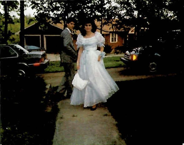 "My high school senior prom.  The dresses were like ""Gone with the Wind"" back then, the makeup was vibrant, and the hair was big."