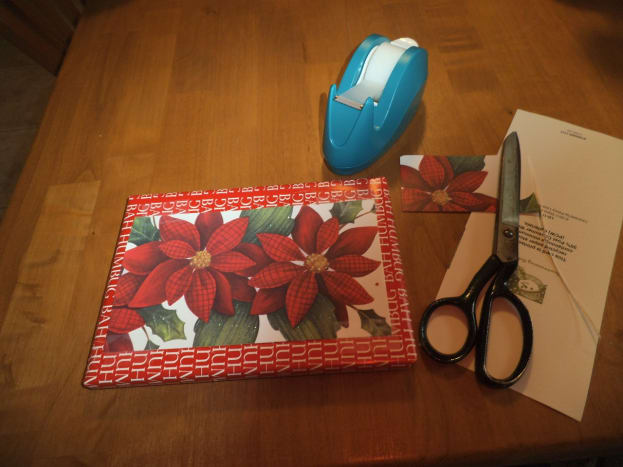 Save the cards from earlier years and cut off the colorful pictures. You can use simple brown paper wrapping which sets off the holiday card nicely. For small gifts, reuse paper saved from last year, cut down to smaller size to remove the tape marks.