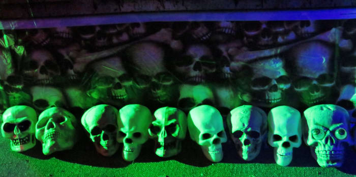 There are lots of skulls at the haunted house exhibit in the National Museum of Funeral History.