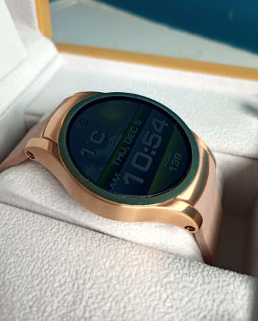 Wear24 smartwatch.  Watch faces dim after a few seconds to conserve battery power.