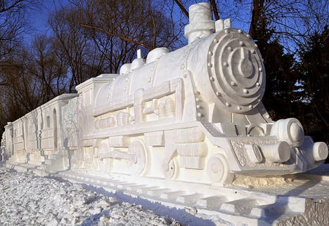 Harbin 2009 Ice & Snow Festival: Snow Train with a Steam Engine on each side. The wagons are partly carved out for visitors to go inside.  This photo was taken by flickr user frankartculinary.
