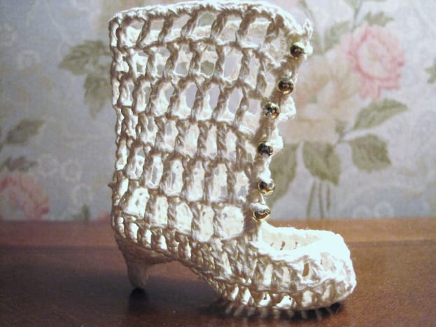 Complete crochet boot. Add decorative buttons to the front of boot.