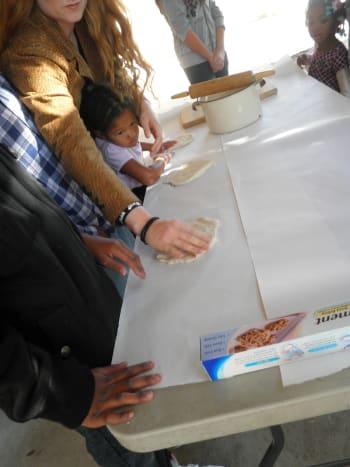 Making kids hand-prints with salt clay dough.