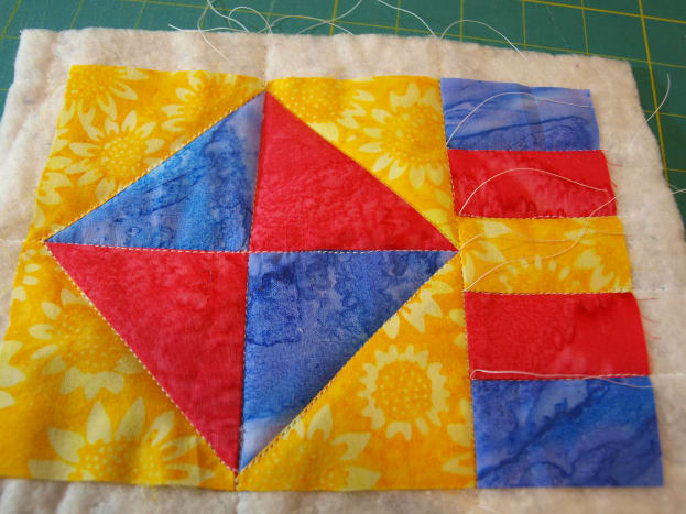 Layer the pieces and quilt.  This mug rug is quilted along the seams.