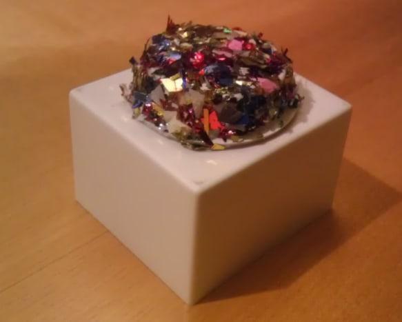 Simple foil confetti adorns this K-cup Barbie hat