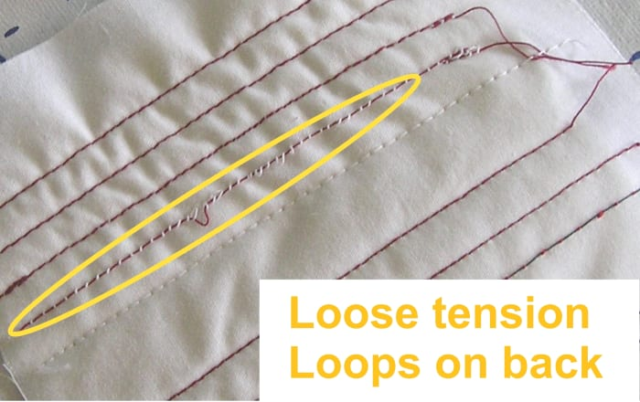 If your thread tension is too low our too loose, loops and/or portions of your top thread will appear on the back of your project. Increase tension.