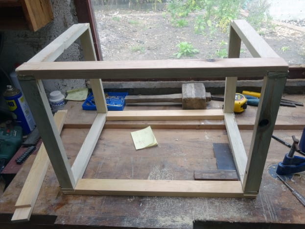 Fitting the pieces together to make the frame.