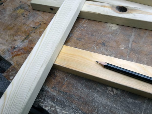 Using the timber as a template to mark the correct position for the joint.