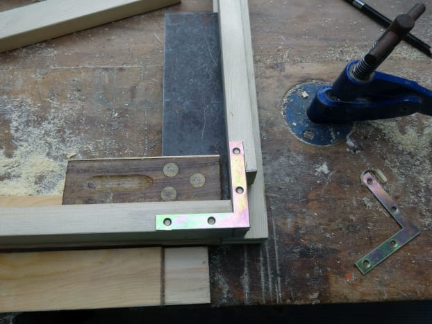 Using metal angle brackets to add strenth to the butt joints.