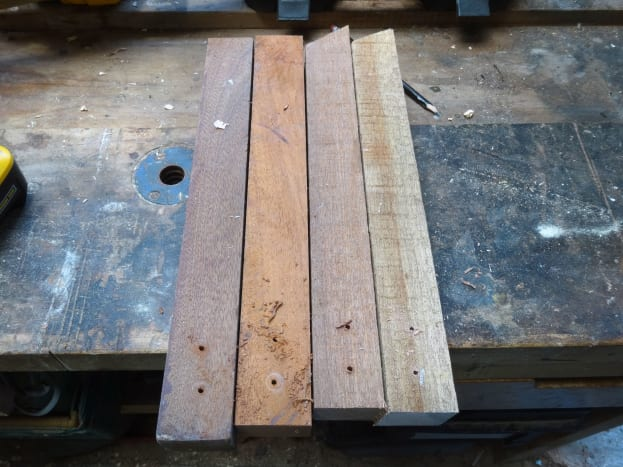 Four lengths of salvaged hardwood teak to be recycled as for the legs for the stand.