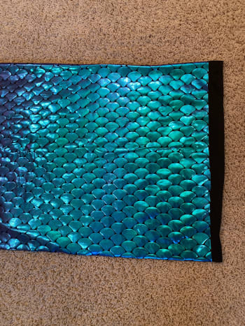 Purchased activewear fabric. The fish scales change from teal to pink with the light.