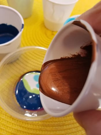 Layering colors of paint.