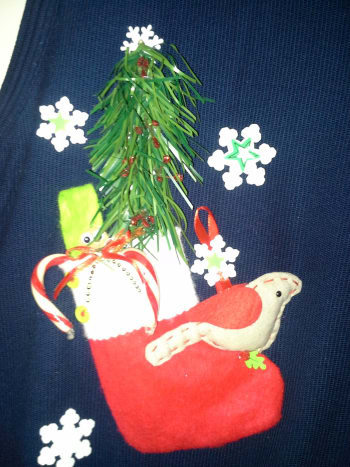 My husband's cotton sweater vest with Christmas ornaments hot glued on.