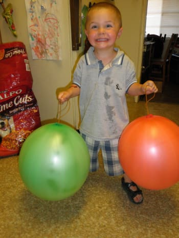 Start with some round balloons or punching bags (I got 3 punching bags at the Dollar Store for a $1)