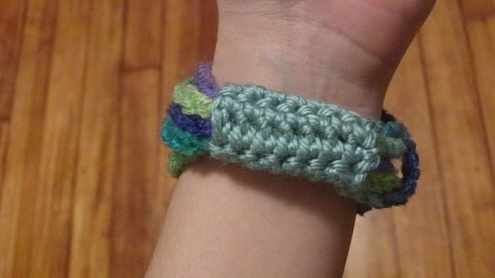 Chain stitch bangle with crocheted band.