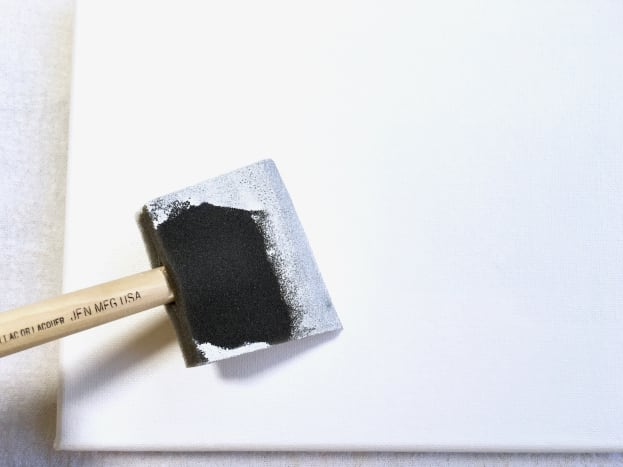 A polyfoam brush is an easy way to apply gesso to a canvas.