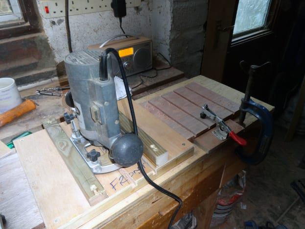 Using the jig to route the divider slots in the drawer sides