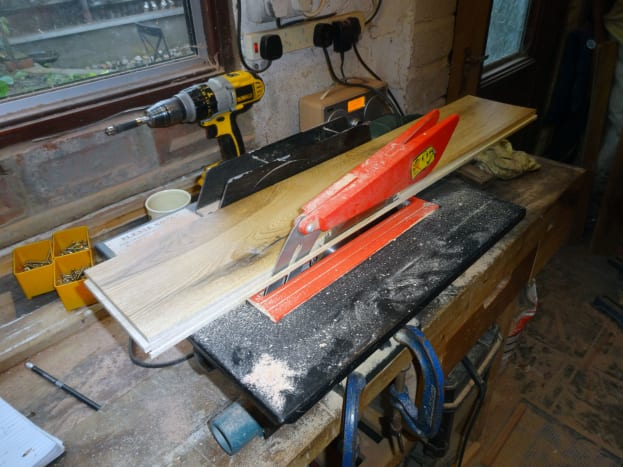 Cutting oak floorboard to size to make plinth drawer front and decorative end pieces