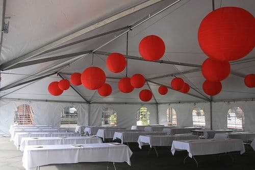 This very chic, no-liner frame tent features cathedral walls and funky ball lights.