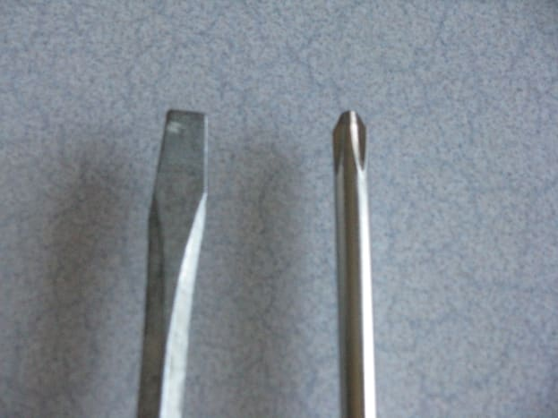 Flat head screw driver on the left, Phillips head screw driver on the right.