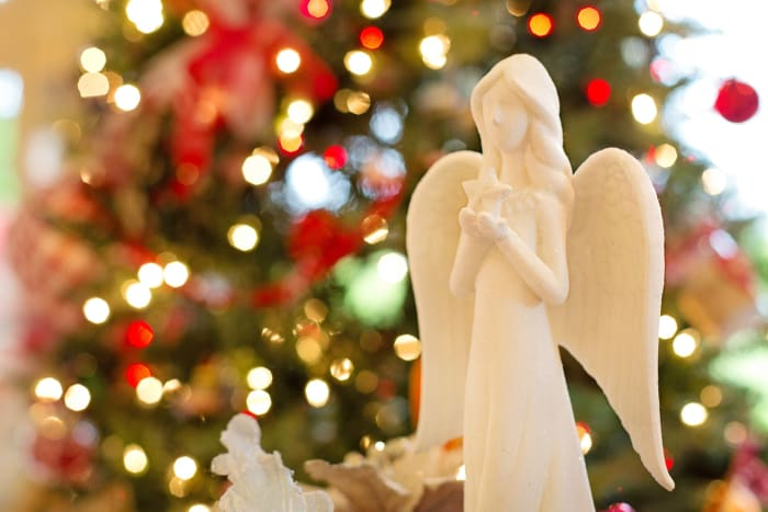 An angel is often placed at the top of a Christmas tree.