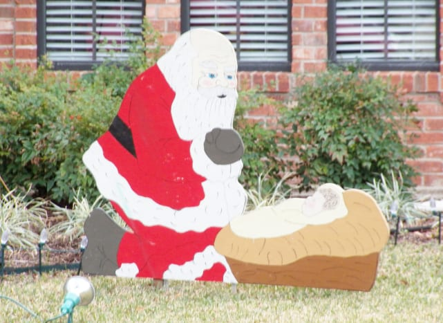 Santa Bowing to Jesus