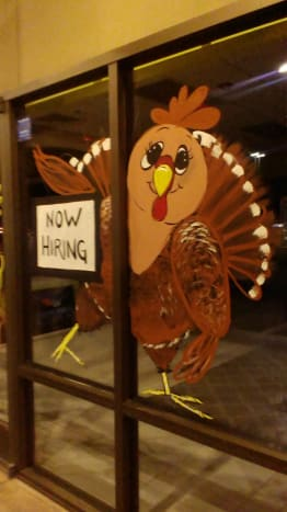 This is my buddy, Trixie Turkey. He arrives during the month of November and hangs out until the end of the month. This scene shows him holding a hiring sign