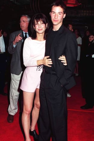 Sandra Bullock with co-star Keanu Reeves at the premiere of 1994's Speed.