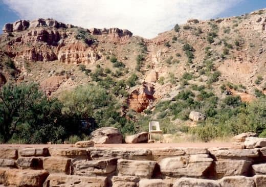 Ground level view of stage with dramatic backdrop at Pioneer Ampitheater in Palo Duro Canyon