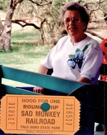 My mother is on the Sad Monkey Railroad ride while touring Palo Duro Canyon.