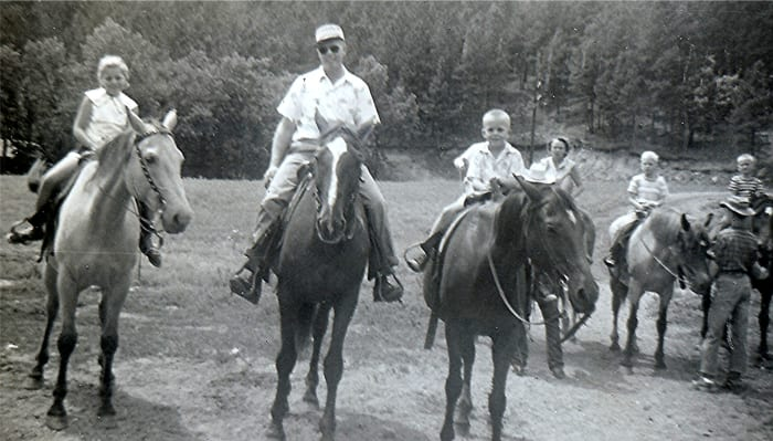 """Couldn't get Carol to go on the horses.  Peggy, Ralph, Johnny"" (Riding horses at Last Frontier Game Lodge, 1950s)"