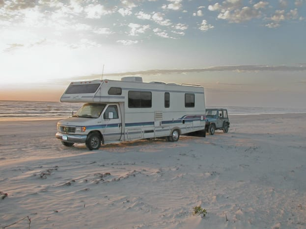 Watch the sunrise on the Gulf of Mexico when you park your RV right on the beach in Padre Island National Seashore.
