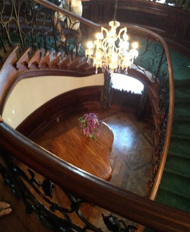 The grand staircase from the second floor.  Shaped like a heart!