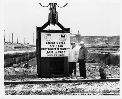 First bucket of concrete at the Kerr Lock and Dam.