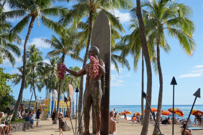 The iconic statue of the father of modern surfing, Duke Kahanamoku, in Waikiki Beach.