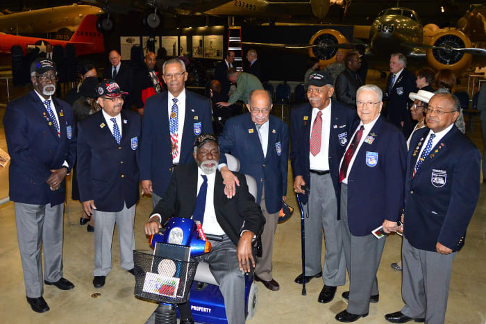 Tuskegee Airmen and Honorary Airmen gathered at the expanded Tuskegee Airmen exhibit in the WWII Gallery at the National Museum of the Air Force in 2015.