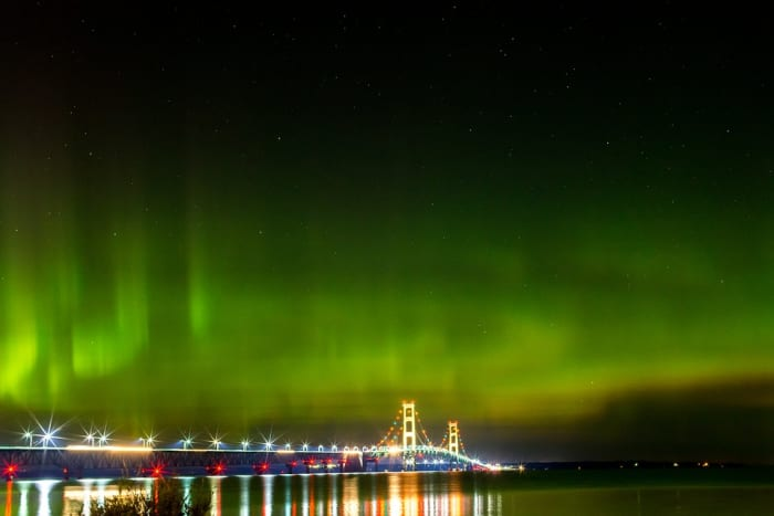 Northern lights above the Mackinac Bridge at night - Mackinaw City, Michigan