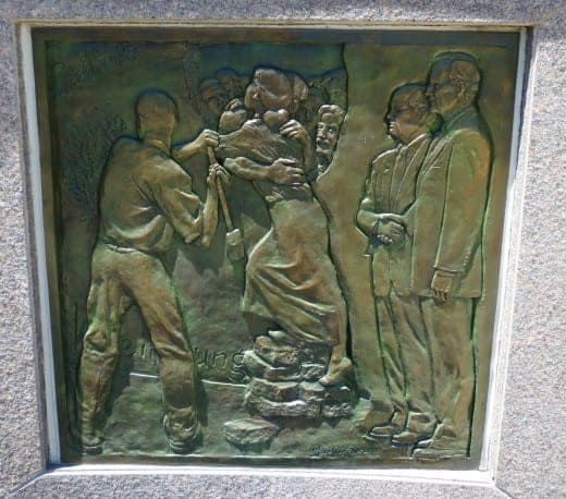 Bas Relief showing the Berlin Wall being torn down with Presidents Bush and Gorbachev to the side.