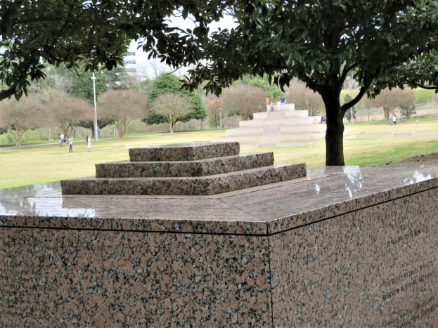 View of the granite monument at the top of the hill with the main monument below.