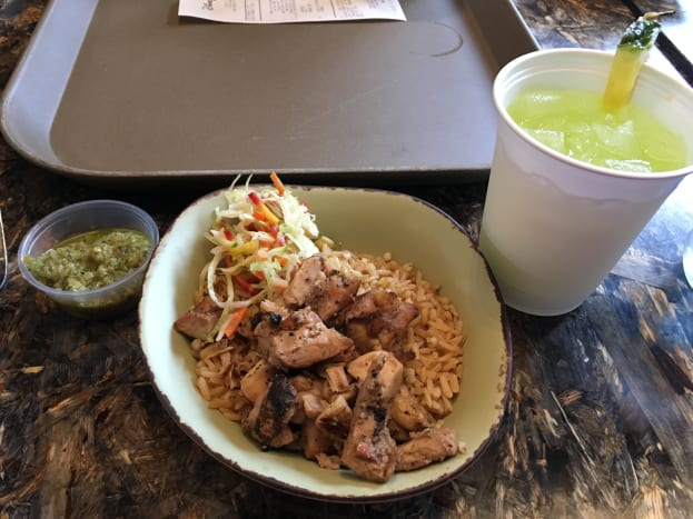The children's chicken and rice bowl. It is brown rice, marinaded chicken, and a veggie slaw on the side. That green stuff is an aioli and is one of the sauce options for the adult version. A very well balanced and delicious meal.